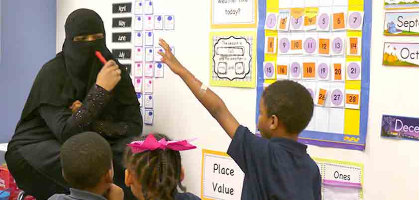 UMUC Alumna Samirah Ali teaches in classroom