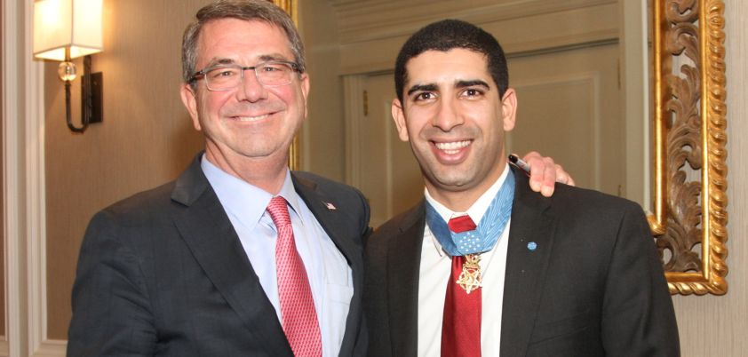 Secretary of Defense Ash Carter with UMUC student Florent Groberg