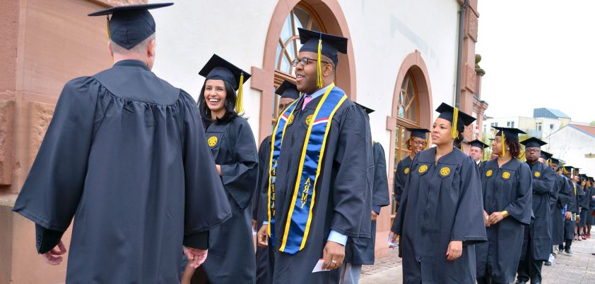 Photo.7.UMUC.Europe.Commencement.2016..Students.Marching.In (1)